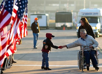 child with a senior war veteran