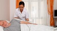 caregiver taking care of senior sleeping