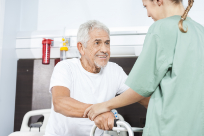 nurse helping smiling senior men
