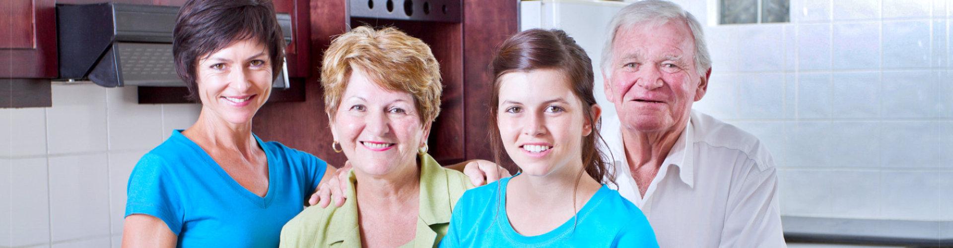 3 generation family portrait in kitchen
