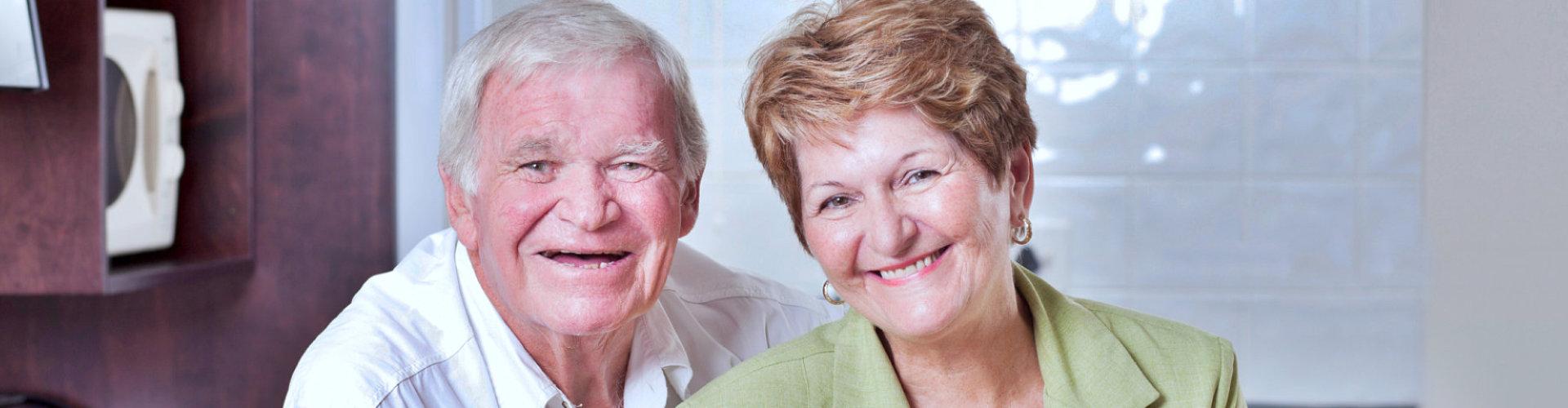 happy loving senior couple portrait at home
